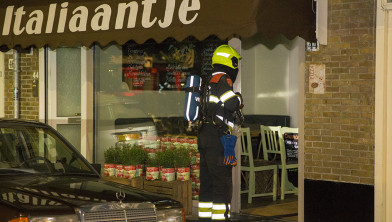 Woningen ontruimd na brand in pizza-oven.