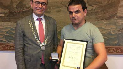 Mohammed Zeheri en burgemeester Jos Wienen.