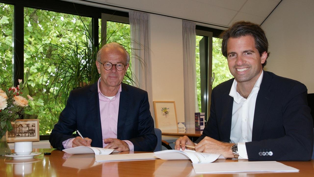 Wethouder Wim van Veelen en Michiel Admiraal van CIF