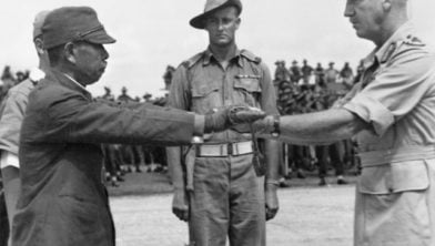 Commander of the Japanese 18th Army in New Guinea, surrenders his sword to the commander of the Australian 6th Division