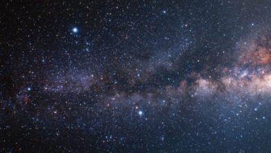 A wide-field ground-based image of the Milky Way plane. The constellation of Cygnus, where the veil nebula is located, appears in the top of the image.